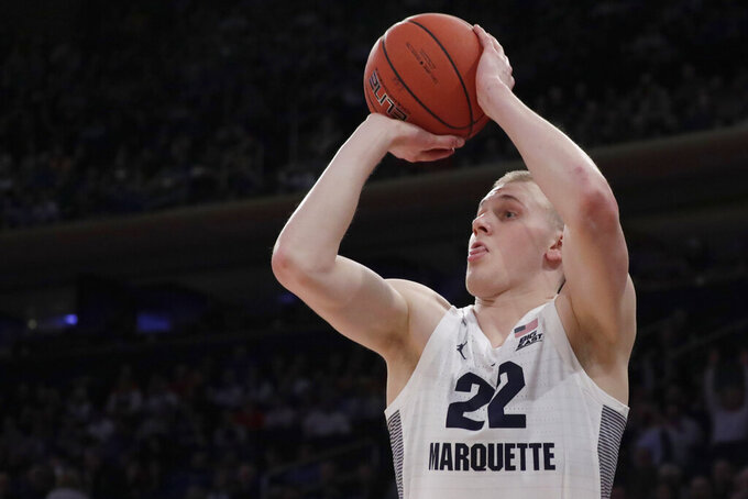 "FILE - In this March 14, 2019, file photo, Marquette forward Joey Hauser shoots against St. John's during the first half of an NCAA college basketball game in the Big East men's tournament, in New York. Michigan State coach Tom Izzo abruptly resigned from a coaches' board Thursday, angered after the NCAA denied an appeal from forward Joey Hauser to play this season. Izzo says the decision led to him resigning from the National Association of Basketball Coaches board of directors because he says the NCAA is making ""arbitrary decisions"" regarding waiver requests. (AP Photo/Julio Cortez, File)"