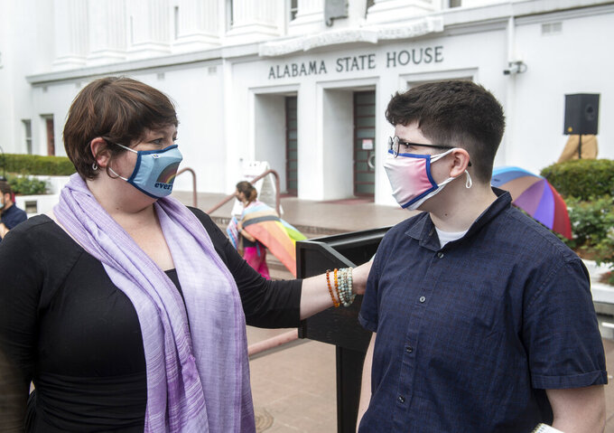 Trace Trice and her son, Phin, talk following a transgender rights rally outside the Alabama State House in Montgomery, Ala., on Tuesday, March 30, 2021. (Jake Crandall/The Montgomery Advertiser via AP)
