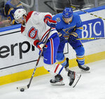 Montreal Canadiens' Jeff Petry (26) gets the puck by St. Louis Blues' Jaden Schwartz (17) during the first period of an NHL hockey game, Saturday, Oct. 19, 2019, in St. Louis. (AP Photo/Bill Boyce)
