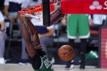 Boston Celtics' Jaylen Brown, celebrates dunking against the Miami Heat during the second half of an NBA conference final playoff basketball game, Saturday, Sept. 19, 2020, in Lake Buena Vista, Fla. (AP Photo/Mark J. Terrill)