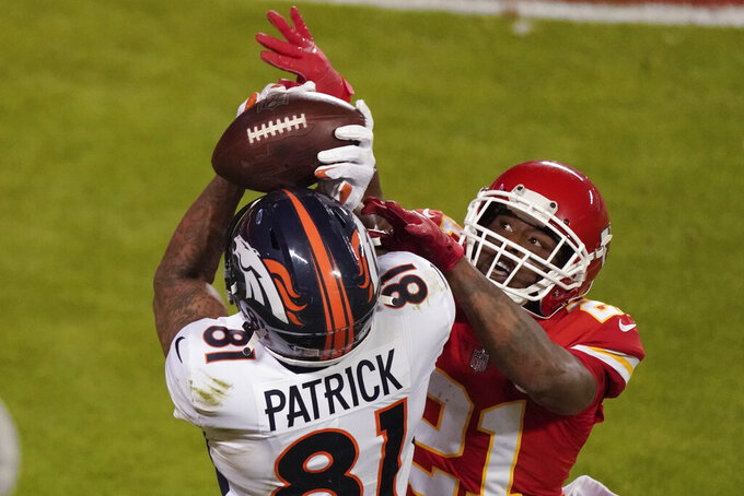 Denver Broncos wide receiver Tim Patrick (81) catches a 10-yard touchdown pass as Kansas City Chiefs cornerback Bashaud Breeland (21) defendsin the second half of an NFL football game in Kansas City, Mo., Sunday, Dec. 6, 2020. (AP Photo/Charlie Riedel )