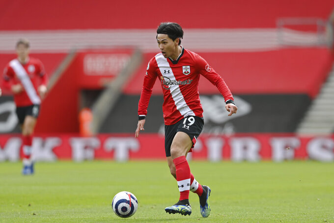 Southampton's Takumi Minamino controls the ball during an English Premier League soccer match between Southampton and Brighton at the St Mary's Stadium in Southampton, England, Sunday March 14, 2021. (Mike Hewitt/Pool via AP)