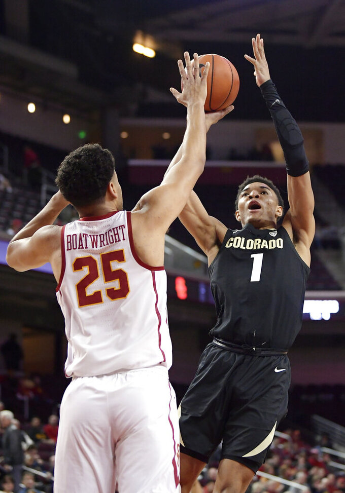 Colorado guard Tyler Bey, right, shoots as Southern California forward Bennie Boatwright defends during the first half of an NCAA college basketball game Saturday, Feb. 9, 2019, in Los Angeles. (AP Photo/Mark J. Terrill)