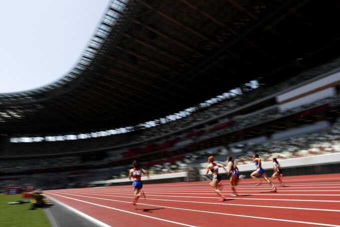 Two Tokyo Olympics: Inside and outside the National Stadium