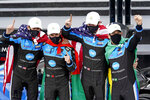 The Konica Minolta racing team, from left to right, Ricky Taylor, Filipe Albuquerque, Alexander Rossi and Helio Castroneves celebrate in Victory Lane after winning the Rolex 24 hour auto race at Daytona International Speedway, Sunday, Jan. 31, 2021, in Daytona Beach, Fla. (AP Photo/John Raoux)