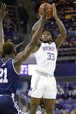 Washington's Isaiah Stewart (33) shoots over Mount St. Mary's Collin Nnamene during the first half of an NCAA college basketball game Tuesday, Nov. 12, 2019, in Seattle. (AP Photo/Elaine Thompson)