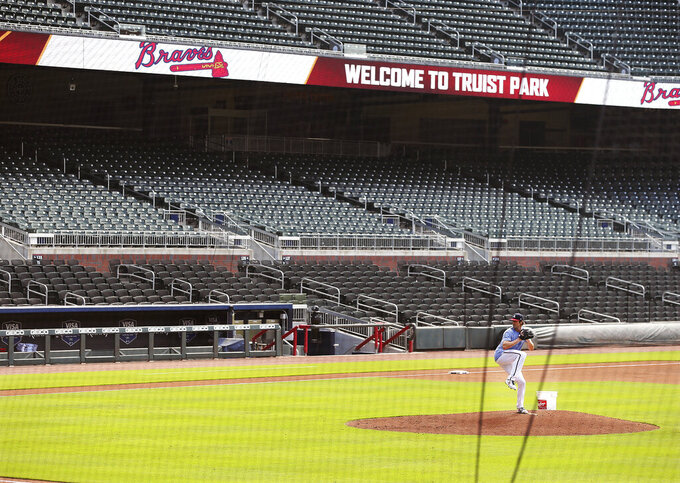 Atlanta Braves pitcher Cole Hamels appears to have Truist Park to himself while working from the mound during baseball practice, Friday July 3, 2020 in Atlanta. (Curtis Compton/Atlanta Journal-Constitution via AP)