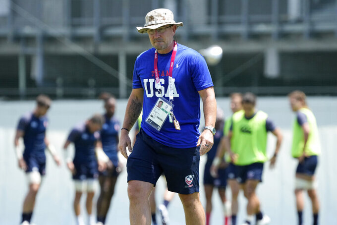 Mike Friday, the coach of the U.S. rugby sevens team walks on the field during a training session at the 2020 Summer Olympics, Sunday, July 25, 2021, in Tokyo. (AP Photo/Shuji Kajiyama)