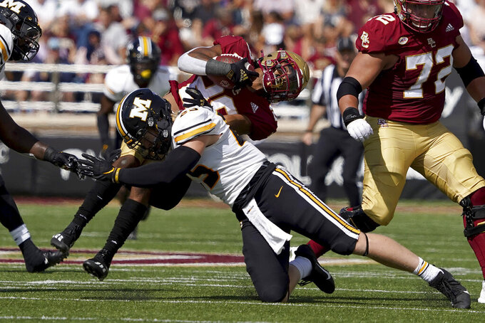 Boston College running back Alec Sinkfield (26) is upended by Missouri linebacker Blaze Alldredge (25) during the first half of an NCAA college football game, Saturday, Sept. 25, 2021, in Boston. (AP Photo/Mary Schwalm)