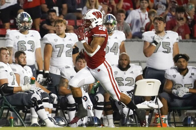 Wisconsin's Isaac Guerendo breaks away for an 82-yard touchdown run during the first half of an NCAA college football game against Eastern Michigan Saturday, Sept. 11, 2021, in Madison, Wis. (AP Photo/Morry Gash)