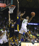 Baylor guard Jared Butler, right, attempts a shot over West Virginia forward Andrew Gordon, left, in the first half of an NCAA college basketball game, Saturday, Feb. 23, 2019, in Waco, Texas. (Rod Aydelotte/Waco Tribune-Herald via AP)