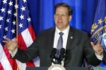 FILE - In this Feb. 10, 2020, file photo New Hampshire Gov. Chris Sununu speaks at a Cops for Trump rally in Portsmouth, N.H. State and local government officials across the U.S. have been on edge for months about how to keep basic services running while covering rising costs related to the coronavirus outbreak as tax revenue plummeted. On Monday, Aug. 10, 2020 governors, lawmakers, mayors, teachers and others said they were going to keep pushing members of Congress to revive the talks and agree to another rescue package.(AP Photo/Robert F. Bukaty, File)