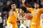 Vanderbilt guard Scotty Pippen Jr. (2) is guarded by Tennessee's Josiah-Jordan James (5) and Santiago Vescovi (25) during the first half of an NCAA college basketball game Saturday, Jan. 18, 2020, in Nashville, Tenn. (AP Photo/Mark Humphrey)