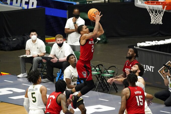 North Carolina State guard Shakeel Moore (2) shoots after getting past Colorado State guard P.J. Byrd (5) and Kendle Moore, rear, during the first half of an NCAA college basketball game in the quarterfinals of the NIT, Thursday, March 25, 2021, in Frisco, Texas. (AP Photo/Tony Gutierrez)
