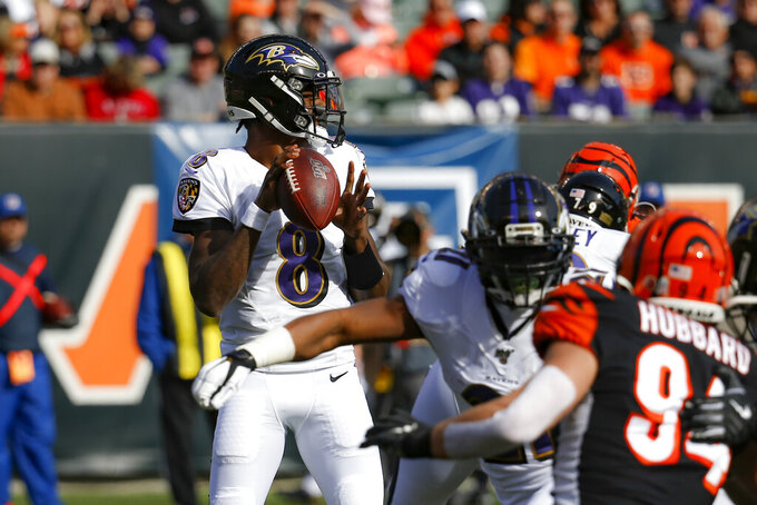 Baltimore Ravens quarterback Lamar Jackson (8) looks to pass during the first half of NFL football game against the Cincinnati Bengals, Sunday, Nov. 10, 2019, in Cincinnati. (AP Photo/Frank Victores)