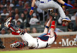 New York Mets' J.D. Davis (28) is tagged out by Atlanta Braves catcher Tyler Flowers (25) as he tries to score on a Wilson Ramos base hit in the sixth inning of a baseball game Wednesday, June 19, 2019, in Atlanta. (AP Photo/John Bazemore)