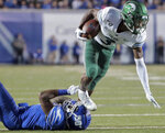 Memphis defensive back T.J. Carter trips Tulane's P.J. Hall during an NCAA college football game Saturday, Oct. 19, 2019, in Memphis, Tenn. (Jim Weber/Daily Memphian via AP)