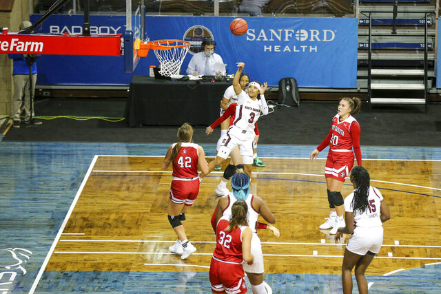 South Carolina guard Destanni Henderson (3) shoots over South Dakota defender Maddie Krull (42) during the first half of an NCAA college basketball game on Saturday, Nov. 28, 2020, in Sioux Falls, S.D. (AP Photo/Josh Jurgens)