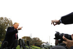 President Donald Trump talks to the media before boarding Marine One on the South Lawn of the White House, Friday, Nov. 9, 2018, in Washington. (AP Photo/Evan Vucci)