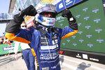 Mclaren driver Daniel Ricciardo of Australia celebrates after winning the Italian Formula One Grand Prix, at Monza racetrack, in Monza, Italy, Sunday, Sept.12, 2021. (Lars Baron/Pool via AP)