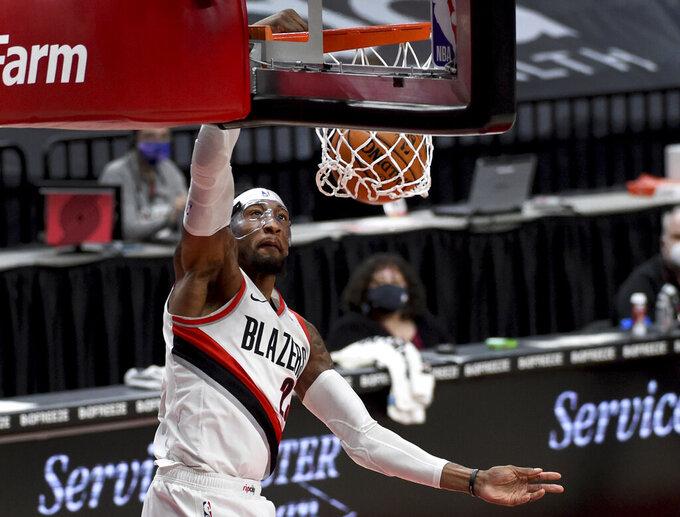 Portland Trail Blazers forward Robert Covington dunks during the first half of the team's NBA basketball game against the Dallas Mavericks in Portland, Ore., Friday, March 19, 2021. AP Photo/Steve Dykes)