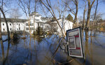 A wayward basketball hoop is seen behind a flooded home Friday, March 22, 2019, in Bellevue, Neb. Flooding in Nebraska has caused an estimated $1.4 billion in damage. The state received Trump's federal disaster assistance approval on Thursday. (Kent Sievers/The World-Herald via AP)/Omaha World-Herald via AP)