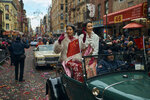 Beauty queens salute the crowd as they travel in a car during the Chinese Lunar New Year parade in Chinatown in New York, Sunday, Feb. 17, 2019. (AP Photo/Andres Kudacki)
