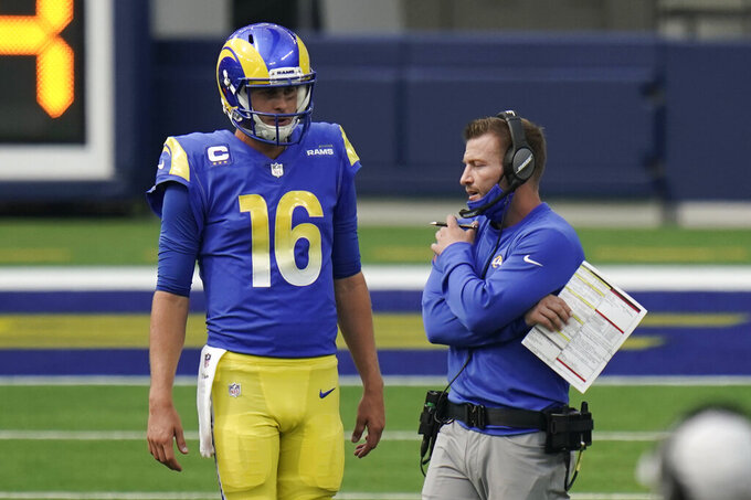 FILE - In this Oct. 4, 2020, file photo, Los Angeles Rams head coach Sean McVay, right, talks to quarterback Jared Goff (16) during the second half of an NFL football game  in Inglewood, Calif. McVay says he cannot talk about Matthew Stafford until the new league year begins in mid-March and the Rams' blockbuster quarterback trade is official. He is still allowed to talk about Goff, but the coach is not saying much. (AP Photo/Jae C. Hong, File)