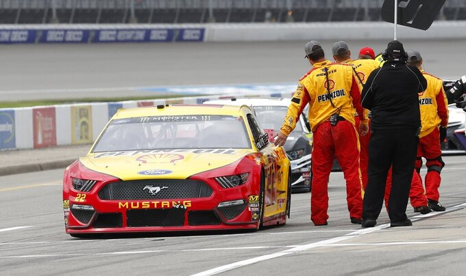 Joey Logano gets a high five from a pit member at the NASCAR cup series auto race at Michigan International Speedway, Monday, June 10, 2019, in Brooklyn, Mich. (AP Photo/Carlos Osorio)