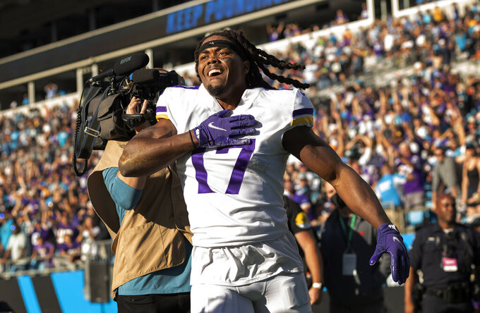Minnesota Vikings receiver K.J. Osborn (17) celebrates after catching a 27-yard touchdown reception in overtime of an NFL football game against the Carolina Panthers, Sunday, Oct. 17, 2021, in Charlotte, N.C. (Carlos Gonzalez/Star Tribune via AP)