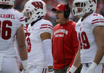 File-This Oct. 27, 2018, file photo shows Wisconsin head coach Paul Chryst talking to his team against Northwestern during the first half of an NCAA college football game in Evanston, Ill. Wisconsin and Miami followed much of the same dreary path that started in the warmth of the Orange Bowl and ends with a frigid thud at Yankee Stadium. The Badgers and Hurricanes were both AP Top 25 teams when they played last season in the Orange Bowl, a 34-24 win for No. 6 Wisconsin in a game that seemed to serve as a preview for a better 2018 ahead for both programs. (AP Photo/Nam Y. Huh, File)