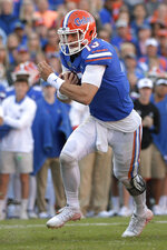 Florida quarterback Feleipe Franks (13) rushes for yardage during the first half of an NCAA college football game against Missouri, Saturday, Nov. 3, 2018, in Gainesville, Fla. (AP Photo/Phelan M. Ebenhack)