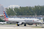 An American Airlines Airbus A321-231 taxies to the gate, Tuesday, Oct. 20, 2020, at Fort Lauderdale-Hollywood International Airport in Fort Lauderdale, Fla.  Airlines are continuing to pile up billions of dollars in losses as the pandemic causes a massive drop in air travel. American Airlines said Thursday, Oct. 22,  that it lost $2.4 billion in the normally strong third quarter, which includes most of the summer vacation season. (AP Photo/Wilfredo Lee)