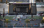 FILE - In this Oct. 3, 2017, file photo, debris litters a concert festival grounds after a Oct. 1 mass shooting in Las Vegas. Aerial footage taken after the deadliest mass shooting in modern U.S. history shows the broken windows of a Las Vegas Strip casino-hotel suite where the gunman fired at a crowd gathered for a music festival in October. Videos released Wednesday, July 11, 2018, by police under court order also show the usually bustling Strip blocked off; runways and planes at McCarran International Airport; and officers pointing their weapons and restraining two people about a mile from the site of the shooting. (AP Photo/John Locher, File)