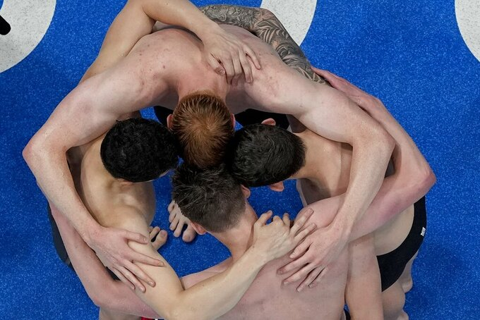 Great Britain celebrates their men's 4 x 200-meter freestyle relay at the 2020 Summer Olympics, Wednesday, July 28, 2021, in Tokyo, Japan. (AP Photo/Morry Gash)