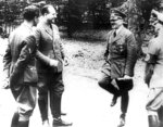 FILE - Adolf Hitler, right, at Compiegne in 1940 after dictating terms to France for their surrender, in Compiegne, north of Paris. The French and German leaders this weekend will jointly visit the remains of the train carriage where the armistice ending World War I was signed on Nov. 11, 1918. For the French, the dining car became a shrine to peace. For Adolf Hitler, it was a symbol of the humiliation of surrender. The Nazi leader had it dragged to Germany after conquering France in World War II. (AP Photo)