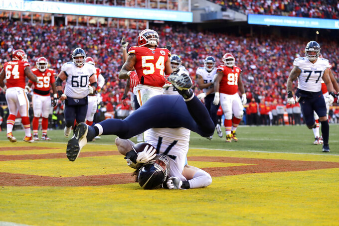 Tennessee Titans' Dennis Kelly (71) catches a touchdown pass during the first half of the NFL AFC Championship football game against the Kansas City Chiefs Sunday, Jan. 19, 2020, in Kansas City, MO. (AP Photo/Jeff Roberson)