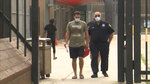 In this screen grab from ABC7, Keegan Casteel leaves jail at the 18th District police headquarters in Chicago July 27, 2021. Keegan, of Ankeny, Iowa, was in custody in Chicago after police found a rifle with a laser sight in a hotel room that overlooks a Lake Michigan beach during the July Fourth weekend. Soon after, he proposed to his girlfriend and she appeared to accept. (ABC7 via AP)