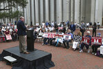 Pastor Kevin Baird speaks to a crowd protesting gambling at the Florida Capitol during a special session centered around passing gambling legislation, Tuesday, May 18, 2021, in Tallahassee, Fla. (AP Photo/Steve Cannon)