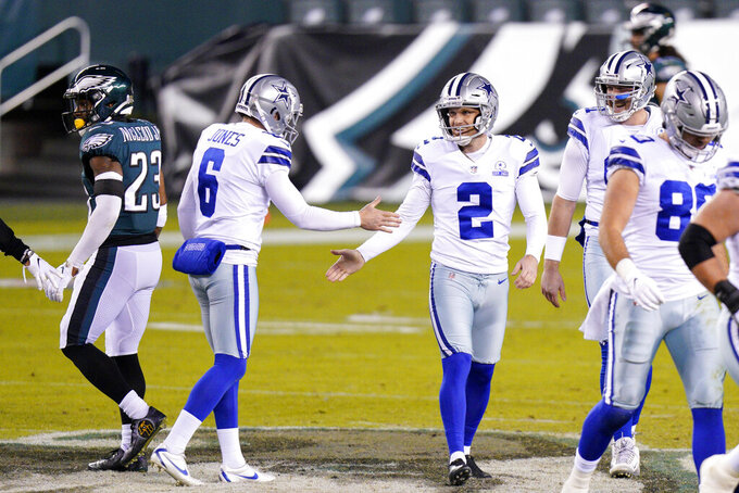 Dallas Cowboys' Greg Zuerlein (2) reacts with teammates after kicking a field goal during the first half of an NFL football game against the Philadelphia Eagles, Sunday, Nov. 1, 2020, in Philadelphia. (AP Photo/Chris Szagola)