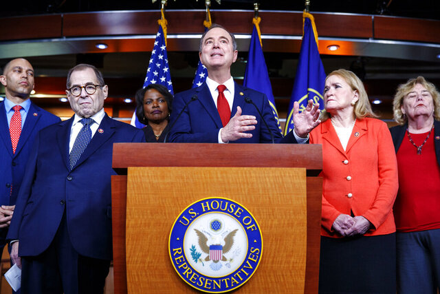 House Intelligence Committee Chairman Adam Schiff, D-Calif., center, joined by fellow House Democratic impeachment managers, from left, Rep. Hakeem Jeffries, D-N.Y., Judiciary Committee Chairman Jerrold Nadler, D-N.Y., Rep. Val Demings, D-Fla., Schiff, Rep. Sylvia Garcia, D-Texas, and Rep. Zoe Lofgren, D-Calif., speaks during a news conference, Tuesday, Jan. 28, 2020, on Capitol Hill in Washington. (AP Photo/ Jacquelyn Martin)
