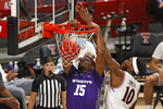 Abilene Christian's Immanuel Allen (15) dunks next to Texas Tech's Tyreek Smith (10) during the first half of an NCAA college basketball game Wednesday, Dec. 9, 2020, in Lubbock, Texas. (AP Photo/Brad Tollefson)