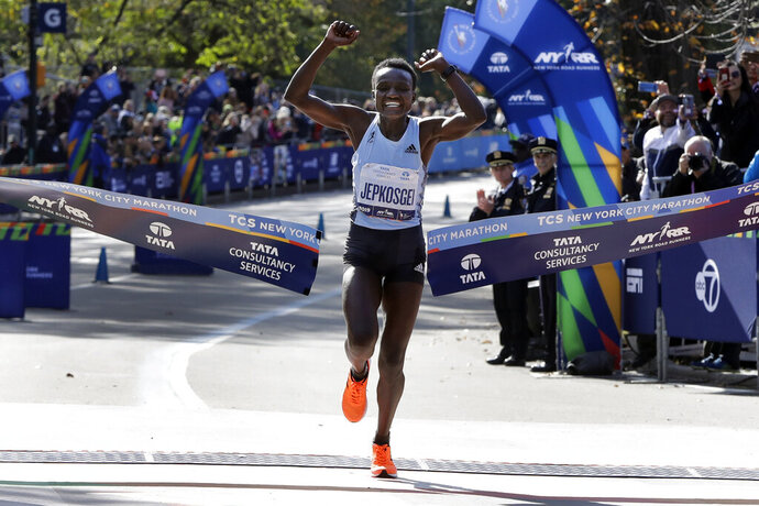 Joyciline Jepkosgei, of Kenya, crosses the finish line to win the Pro Women's Division of the New York City Marathon, in New York's Central Park, Sunday, Nov. 3, 2019. (AP Photo/Richard Drew)