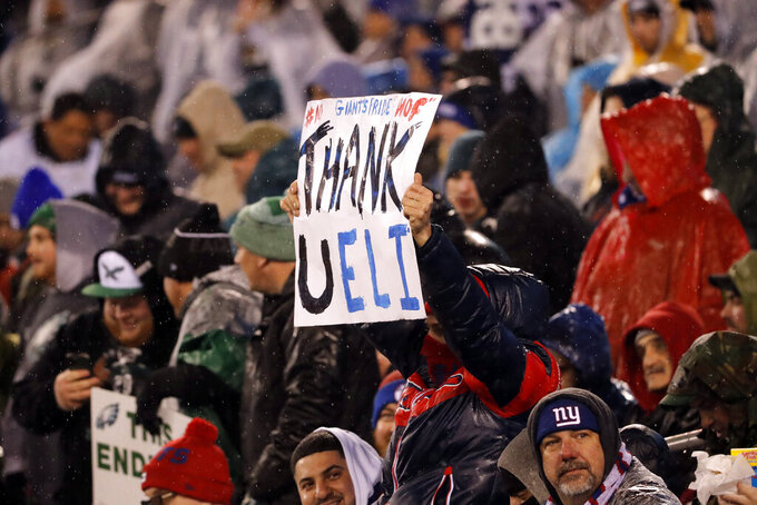 A fan holds a sign for New York Giants quarterback Eli Manning (10) in the second half of an NFL football game against the Philadelphia Eagles, Sunday, Dec. 29, 2019, in East Rutherford, N.J. (AP Photo/Seth Wenig)