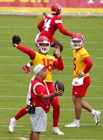 Kansas City Chiefs quarterback Patrick Mahomes (15) passes during drills at the team's NFL football training camp Saturday, July 31, 2021 in St. Joseph, Mo. (AP Photo/Ed Zurga)