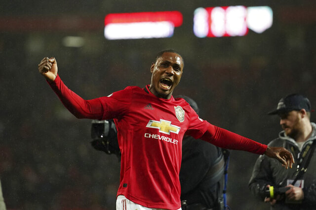Manchester United's Odion Ighalo celebrates after the English Premier League soccer match between Manchester United and Manchester City at Old Trafford in Manchester, England, Sunday, March 8, 2020. Manchester United won 2-0. (AP Photo/Dave Thompson)