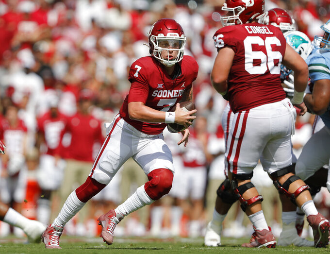 Oklahoma quarterback Spencer Rattler (7) scrambles to find an opening on a play against Tulane during a NCAA college football game Saturday, Sept. 4, 2021, in Norman, Okla. (AP Photo/Alonzo Adams)
