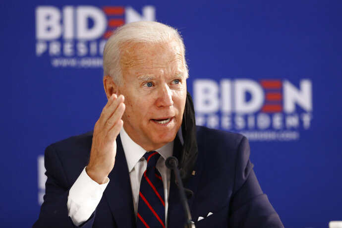 In this June 11, 2020, photo, Democratic presidential candidate former Vice President Joe Biden speaks during a roundtable on economic reopening with community members in Philadelphia. Biden's search for a running mate is entering a second round of vetting for a dwindling list of potential vice presidential nominees, with several black women in strong contention. (AP Photo/Matt Slocum)