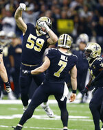 New Orleans Saints quarterback Taysom Hill (7) celebrates his first down carry on a fake punt, with linebacker Vince Biegel (59) in the first half of an NFL divisional playoff football game in New Orleans, Sunday, Jan. 13, 2019. (AP Photo/Butch Dill)