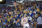 Murray State's Anthony Smith (24) dunks as Belmont's Tyler Scanlon (0) watches during the second half of an NCAA college basketball game for the championship of the Ohio Valley Conference men's tournament Saturday, March 7, 2020, in Evansville, Ind. (AP Photo/Daniel R. Patmore)